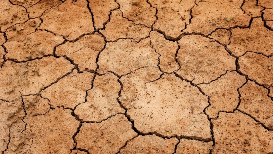 Image of dry cracked Earth during drought.